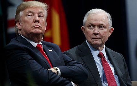 In this Dec. 15, 2017, file photo, President Donald Trump sits with Attorney General Jeff Sessions during the FBI National Academy graduation ceremony in Quantico, Va.(AP/Evan Vucci)