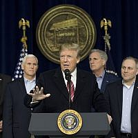 US President Donald Trump, center, accompanied by from left, Senate Majority Leader Mitch McConnell of Ky., Vice President Mike Pence, House Majority Leader Kevin McCarthy of Calif., House Majority Whip Steve Scalise, R-La., Secretary of State Rex Tillerson, at Camp David, Md., Saturday, Jan. 6, 2018. (AP Photo/Andrew Harnik)
