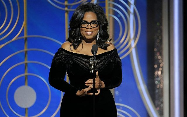 This image released by NBC shows Oprah Winfrey accepting the Cecil B. DeMille Award at the 75th Annual Golden Globe Awards in Beverly Hills, Calif., on Sunday, January 7, 2018. (Paul Drinkwater/NBC via AP)