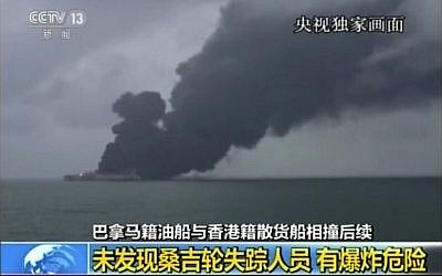 "In this image made from video run by China's CCTV, a rescue ship sprays water to put out a blaze at the Panama-registered tanker ""Sanchi"" after a collision with a Hong Kong-registered freighter off China's eastern coast, January 8, 2017. (CCTV via AP Video)"