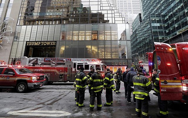 New York City Fire Department vehicles sit on Fifth Avenue in front of Trump Tower, in New York, on January 8, 2018. (AP Photo/Richard Drew)