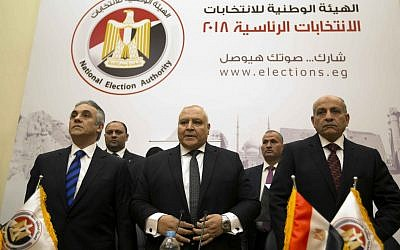 Lasheen Ibrahim, head of the National Electoral Commission, which is in charge of supervising the 2018 Egyptian presidential election, center, and members of the commission prepare to give a press conference at the commission headquarters in Cairo, Egypt, January 8, 2018. (AP Photo/Amr Nabil)