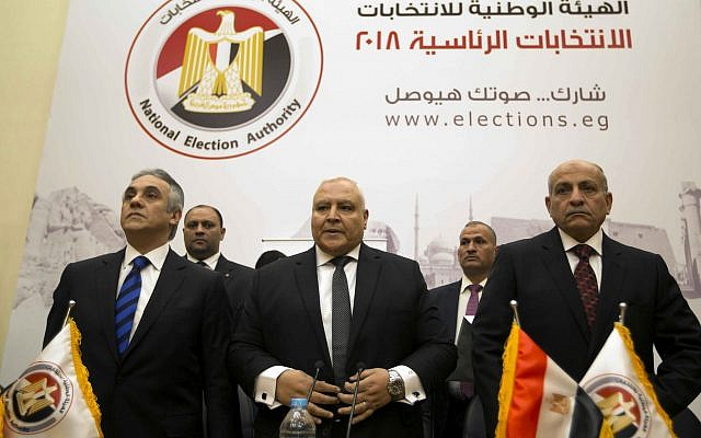 Lasheen Ibrahim, head of the National Electoral Commission, which is in charge of supervising the 2018 Egyptian presidential election, center, and members of the commission prepare to give a press conference at the commission headquarters in Cairo, Egypt, on January 8, 2018. (AP Photo/Amr Nabil)