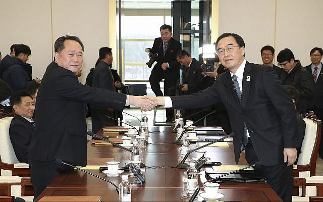 South Korean Unification Minister Cho Myoung-gyon, right, shakes hands with the head of North Korean delegation Ri Son Gwon before their meeting at the Panmunjom in the Demilitarized Zone in Paju, South Korea, Tuesday, January 9, 2018. (Korea Pool/Yonhap via AP)
