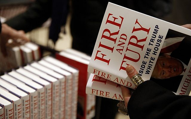 """A customer looks at a copy of Michael Wolff's """"Fire and Fury: Inside the Trump White House"""" as they go on sale at a bookshop, in London, Tuesday, Jan. 9, 2018.  (AP Photo/Alastair Grant)"""