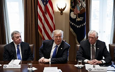 In this January 9, 2017, photo, Sen. Dick Durbin, D-Ill., left, and Rep. Steny Hoyer, D-Md. listen as US President Donald Trump speaks during a meeting with lawmakers on immigration policy in the Cabinet Room of the White House in Washington. (AP Photo/Evan Vucci)