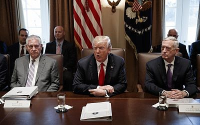 Secretary of State Rex Tillerson, left, and Secretary of Defense Jim Mattis, right, listen as President Donald Trump speaks during a cabinet meeting at the White House, January 10, 2018, in Washington. (AP Photo/Evan Vucci)
