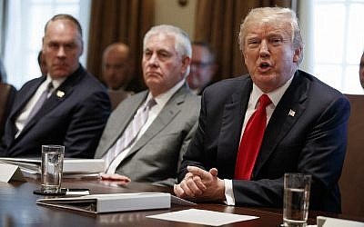 US President Donald Trump speaks during a cabinet meeting at the White House, Wednesday, Jan. 10, 2018, in Washington. From left, Secretary of Interior Ryan Zinke, Secretary of State Rex Tillerson, and Trump. (AP Photo/Evan Vucci)