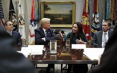 US President Donald Trump looks toward Brooke Rollins, president and CEO of the Texas Public Policy Foundation, as she speaks during a prison reform roundtable in the White House, January 11, 2018. (AP/Carolyn Kaster)