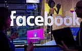 Conference workers speak in front of a demo booth at Facebook's annual F8 developer conference in San Jose, California, April 18, 2017. (AP/Noah Berger)