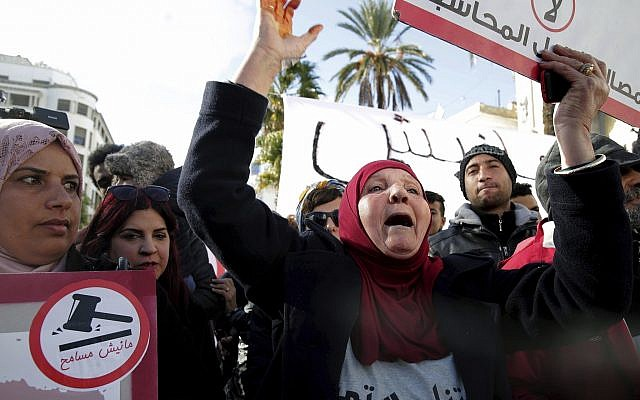Family members of Tunisians who died in the revolution seven years ago, stage a protest in Tunis, Tunisia, January 13, 2018. (AP Photo/Hassene Dridi)