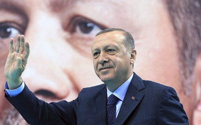 Turkey's President Recep Tayyip Erdogan waves to supporters of his ruling Justice and Development Party (AKP), at a rally in Elazig, eastern Turkey, Saturday, January 13, 2018. (Pool Photo via AP)