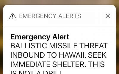This smartphone screen capture shows a false incoming ballistic missile emergency alert sent from the Hawaii Emergency Management Agency system on Saturday, Jan. 13, 2018. (AP Photo/Caleb Jones)