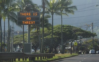 "This January 13, 2018, photo provided by Jhune Liwanag shows a highway median sign broadcasting a message of ""There is no threat"" in Kaneohe, Hawaii. (Jhune Liwanag via The AP)"