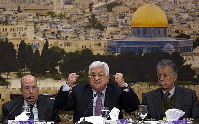 Palestinian Authority President Mahmoud Abbas speaks during a meeting with the Palestinian Central Council, a top decision-making body, at his headquarters in the West Bank city of Ramallah, January 14, 2018. (AP Photo/Majdi Mohammed,l)