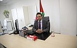 In this January 10, 2018, photo, Palestinian cellphone provider Wataniya CEO Durgham Maraee speaks with the Associated Press at his office in the West Bank city of Ramallah. (AP Photo/Majdi Mohammed)