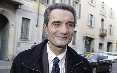 Attilio Fontana arrives for a news conference at the Palazzo ex Stelline, in Milan, Italy, January 11, 2018. (AP Photo/Luca Bruno, File)