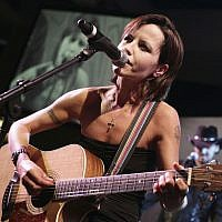 In this Jan. 27, 2008 file photo, Cranberries lead singer Dolores O'Riordan performs during the European Border Breakers awards, or EBBA awards, in Cannes, southern France. (AP Photo/Bruno Bebert, File)