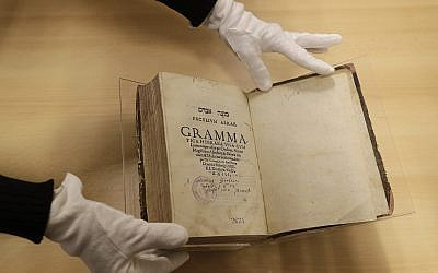 The book titled 'Mikne Avram - Peculium Abrae' is displayed at the Prague's Jewish Museum in Prague, Czech Republic, January 16, 2018. (AP Photo/Petr David Josek)