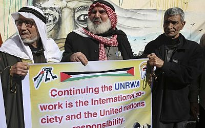 Palestinians protest against the US for withholding $65 million from Palestinian aid programs, in front of the UN Relief and Works Agency offices in the Nusseirat refugee camp, central Gaza Strip, January 17, 2018.  (AP Photo/Adel Hana)