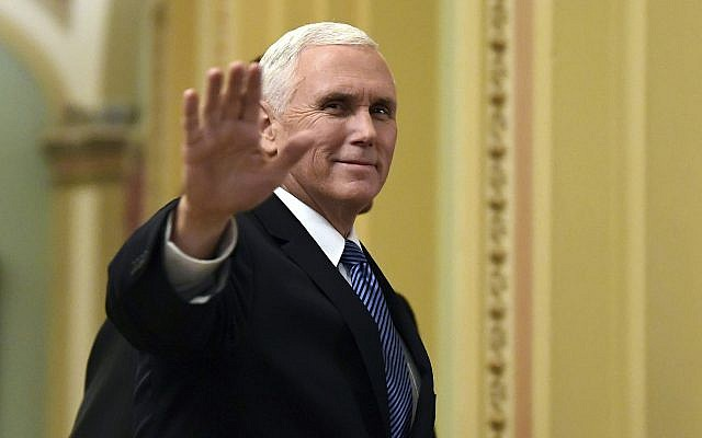 In this Jan. 3, 2018, file photo, US Vice President Mike Pence waves as he walks on Capitol Hill in Washington. (AP Photo/Susan Walsh, File)