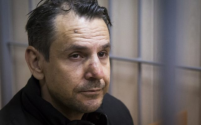 In this file photo taken on Tuesday, Oct. 24, 2017, Boris Grits, 48, who holds Russian and Israeli citizenship, sits in a cage in a courtroom in Moscow, Russia. (AP Photo/Alexander Zemlianichenko)