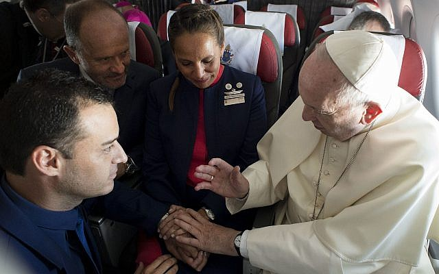 Pope Francis marries flight attendants Carlos Ciuffardi, left, and Paola Podest, center, during a flight from Santiago, Chile, to Iquique, Chile, January 18, 2018. (L'Osservatore Romano Vatican Media/Pool Photo via AP)