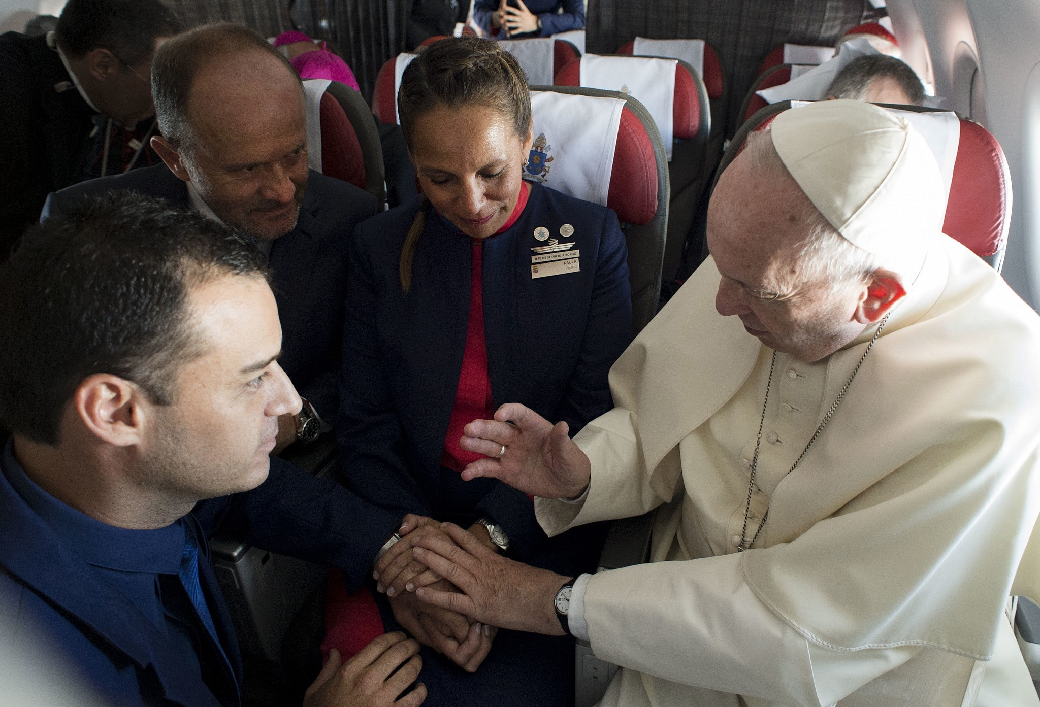 Pope marries couple on papal plane in chile the times of israel pope francis marries flight attendants carlos ciuffardi left and paola podest center kristyandbryce Image collections