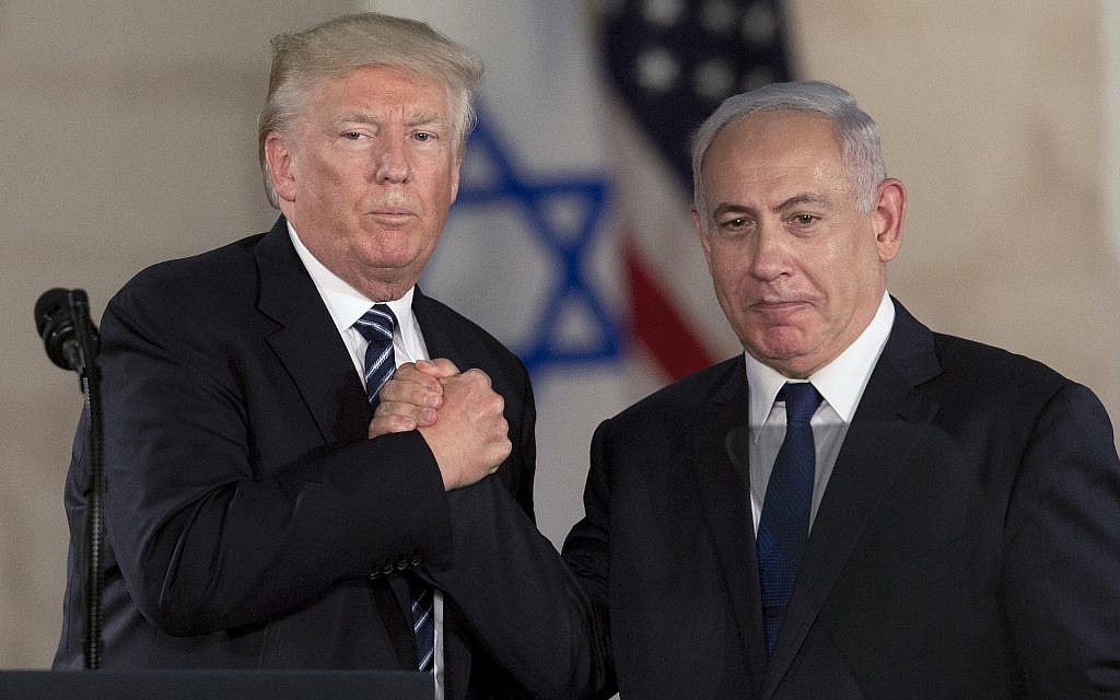 In this Tuesday, May 23, 2017 file photo, US President Donald Trump, left, shakes hands with Israeli Prime Minister Benjamin Netanyahu at the Israel Museum in Jerusalem (AP Photo/Sebastian Scheiner, File)