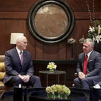 US Vice President Mike Pence, left, meets with King Abdullah II at the Husseiniya Palace in Amman, Jordan, Sunday, January 21, 2018. (AP Photo/Raad Adayleh)