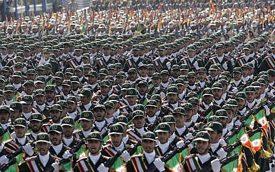 Iran's Revolutionary Guard troops march before the shrine of the late revolutionary founder Ayatollah Khomeini, just outside Tehran, to commemorate the anniversary of the start of the 1980-88 Iraq-Iran war. (AP Photo/Vahid Salemi, File)