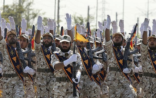 Iran's Revolutionary Guard members march during an armed forces parade marking the anniversary of the start of the 1980-88 Iraq-Iran war, in front of the shrine of the late revolutionary founder Ayatollah Khomeini, just outside Tehran, Iran, on September 22, 2011. (AP Photo/Vahid Salemi, File)