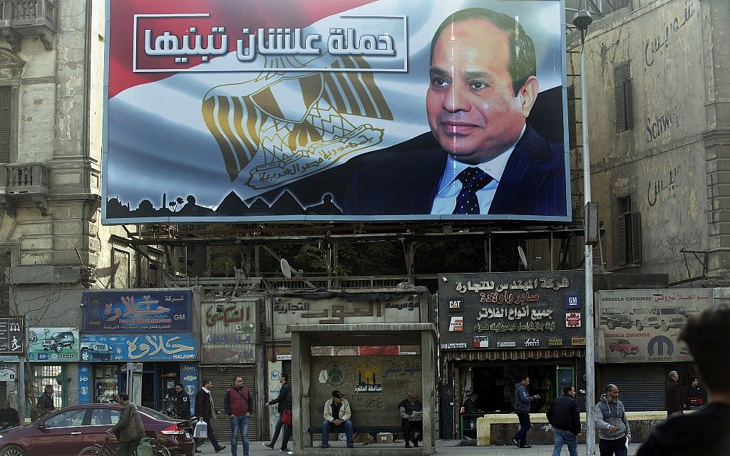 A billboard supporting Egyptian President Abdel-Fattah el-Sissi in the presidential election scheduled for March hangs in downtown Cairo, Egypt, on January 22, 2018. (AP Photo/Amr Nabil)