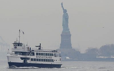 A Statue of Liberty and Ellis Island tour boat passes by the Statue of Liberty after dropping passengers off there on January 22, 2018, in New York. (AP Photo/Kathy Willens)