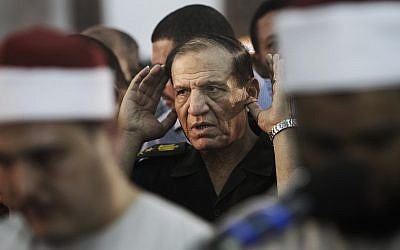 Then-Egyptian armed forces chief of staff Sami Annan performs prayers for 16 Egyptian soldiers who were killed, in Cairo, Egypt, August 5, 2012. (AP Photo/Amr Nabil, File)