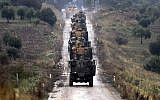 A convoy of Turkish Army armored personnel carriers led by a tank are driven toward the border with Syria, in the outskirts of Hassa, Turkey, Tuesday, January 23, 2018. (Ibrahim Mase/DHA-Depo Photos via AP)