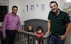 Elad Dvash-Banks, left, and his partner, Andrew, pose for photos with their twin sons, Ethan, center right, and Aiden in their apartment Tuesday, Jan. 23, 2018, in Los Angeles. (AP Photo/Jae C. Hong)