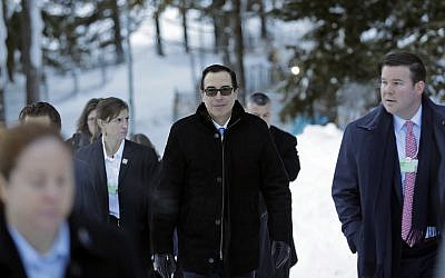 Steven Mnuchin, United States Secretary of the Treasury, walks through the snow during the annual meeting of the World Economic Forum in Davos, Switzerland, January 24, 2018. (Markus Schreiber/AP)