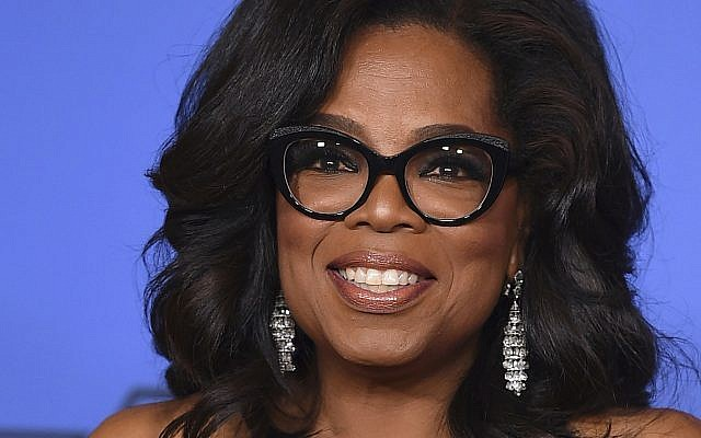 In this file photo from January 7, 2018, Oprah Winfrey poses in the press room with the Cecil B. DeMille Award at the 75th annual Golden Globe Awards in Beverly Hills, California. (Jordan Strauss/Invision/AP, File)