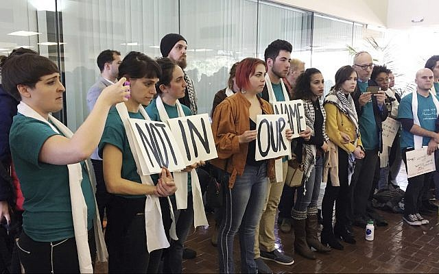 Demonstrators line up outside a meeting room protesting the New Orleans City Council vote rescinding a human rights resolution backed by BDS groups during a meeting in New Orleans, Thursday, Jan. 25, 2018. (AP Photo/Kevin McGill)