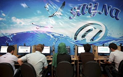 In this file photo from September 17, 2013, Iranians surf the Internet at a cafe in Tehran, Iran. (AP Photo/Ebrahim Noroozi, File)
