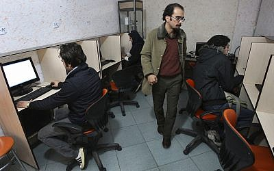 In this file photo from January 18, 2011, Iranians work in an internet cafe in central Tehran, Iran. (AP Photo/Vahid Salemi, File)