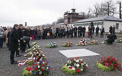 People mourn on the occasion of International Holocaust Remembrance Day in the former Nazi concentration camp Buchenwald, January 26, 2018.  (AP Photo/Jens Meyer)