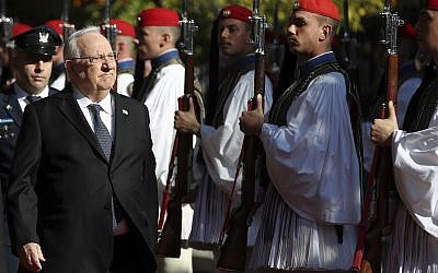 President Reuven Rivlin reviews the Presidential Guard, during a welcome ceremony by his Greek counterpart, Prokopis Pavlopoulos, in Athens, January 29, 2018. (AP Photo/Thanassis Stavrakis)