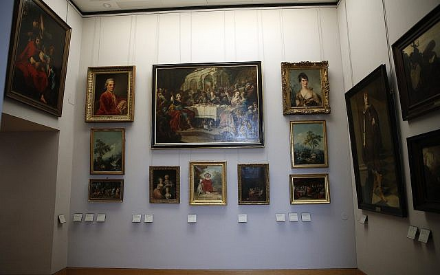 Paintings looted by Nazis during World War II are on display at the Louvre museum in Paris, Tuesday, January 30, 2018. (AP Photo/Christophe Ena)
