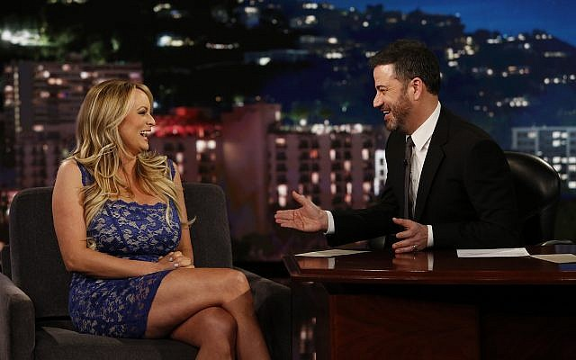 Adult film star Stormy Daniels, left, with host Jimmy Kimmel during an appearance on 'Jimmy Kimmel Live!,' January 30, 2018. (Randy Holmes/ABC via AP)