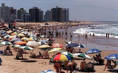 Illustrative: Beachgoers fill the beach in Punta del Este, Uruguay, Feb 4, 2001. (AP Photo/Diego Giudice)