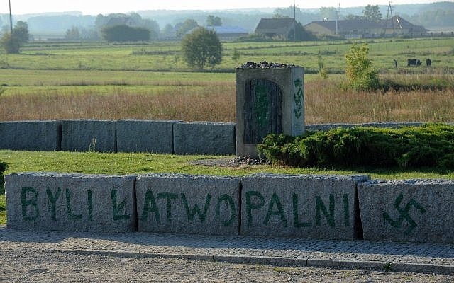 An inscription reading 'They were Flammable' and a Nazi swastika are seen in Jedwabne, Poland, September 1, 2011, on the monument dedicated to Jews from the town of Jedwabne burned to death by their Polish neighbors in 1941. (AP/Michal Kosc/File)