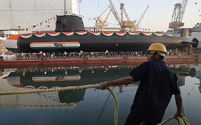 A worker pulls a rope during the launch of Khanderi, India's second Scorpene class submarine at the Mazagon Dock Shipbuilders Limited in Mumbai, India, Thursday, Jan.uary12, 2017. (illustrative photo: AP/Rafiq Maqbool)