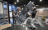Elizabeth Tinker and Noah Smalls install an American Friends Service Committee exhibit at the African American Museum in Philadelphia, Tuesday, January 10, 2017. (AP/Matt Rourke)